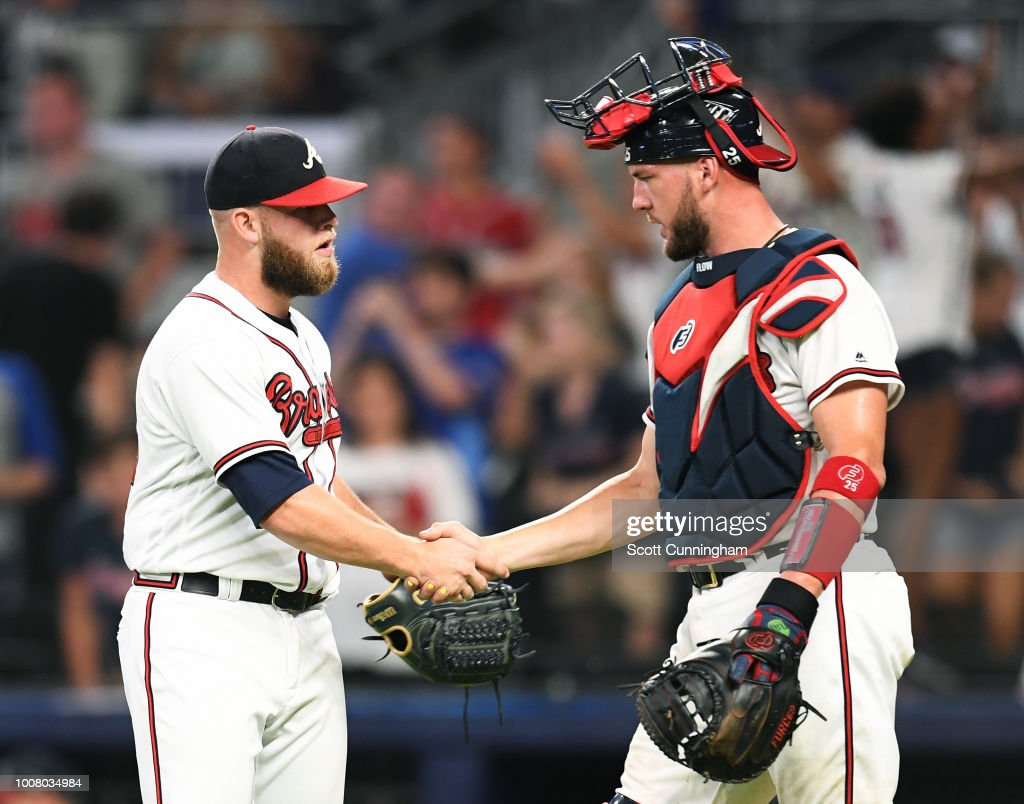 A. J. Minter #33 and Tyler Flowers #25 of the Atlanta Braves celebrate after the game against the Miami Marlins at SunTrust Park on July 30, 2018 in Atlanta, Georgia.