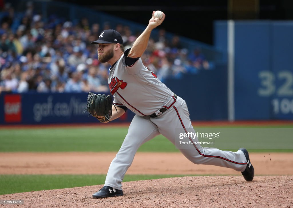 A.J. Minter #33 of the Atlanta Braves delivers a pitch in the seventh inning during MLB game action against the Toronto Blue Jays at Rogers Centre on June 20, 2018 in Toronto, Canada.