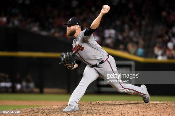 J Minter of the Atlanta Braves delivers a pitch in the tenth inning of the MLB game against the Arizona Diamondbacks at Chase Field on September 8...