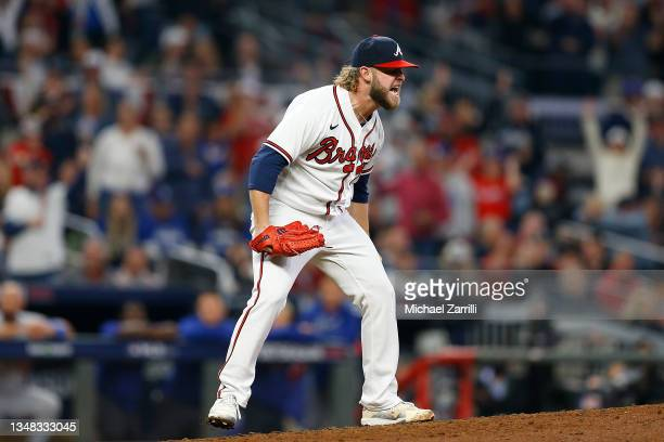 Minter of the Atlanta Braves reacts after striking out Mookie Betts of the Los Angeles Dodgers during the fifth inning of Game Six of the National...