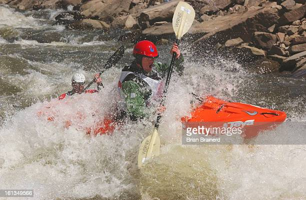 Minturn, Colo., June 8, 2003 -- Racers in the Long Boat final ride into the Dowd Chute behind <cq>Hommy Hillike,<cq> #177, on the Eagle River Sunday...