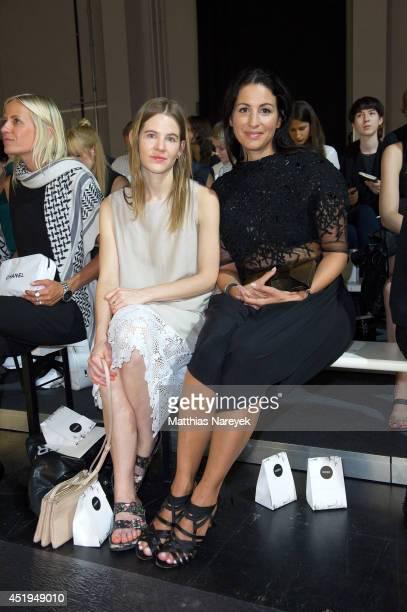 Minu Barati and Aino Labernz attend the Dawid Tomaszewski show during the MercedesBenz Fashion Week Spring/Summer 2015 at Tischlerei der Deutschen...