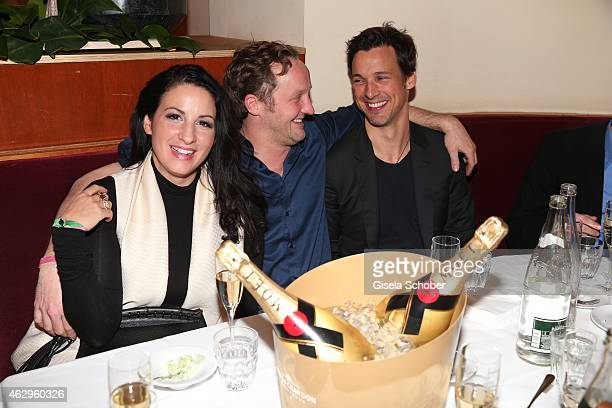 Minu Barati Fischer Maximilian Brueckner and Florian David Fitz attend the Bild 'Place to B' Party at Borchardt Restaurant on February 7 2015 in...