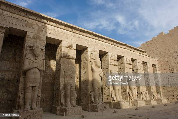 Minus tourists the tall Ramessid columns in the peristyle court at the ancient Egyptian site of Medinet Habu the Mortuary Temple of Ramesses III in...