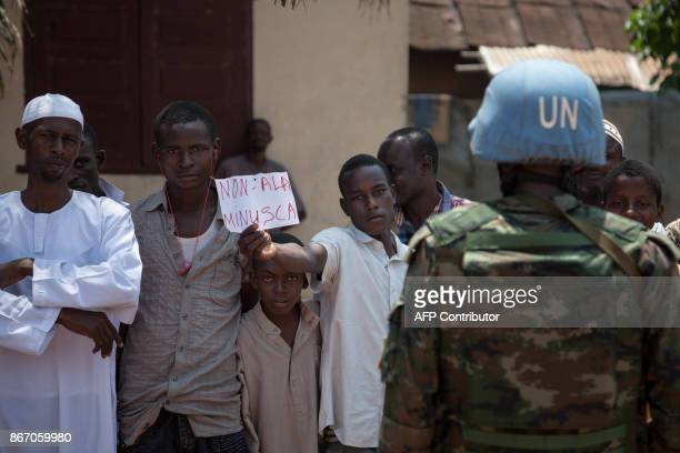 A Minusca peacekeeper stands guard as Muslims in Bangui's Pk5 neighbourhood demonstrate against the Minusca peacekeeping force during the visit of...