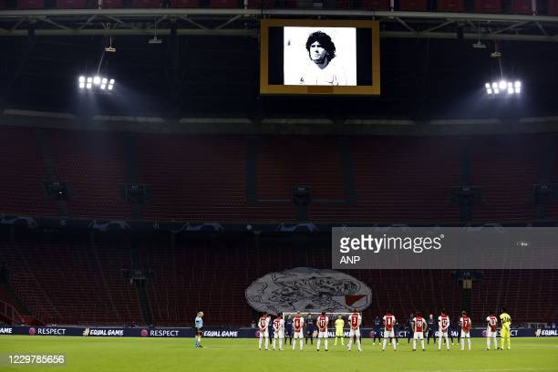 Minute of silence for Diego Maradona during the UEFA Champions League match between Ajax Amsterdam and FC Midtjylland at the Johan Cruijff Arena on...