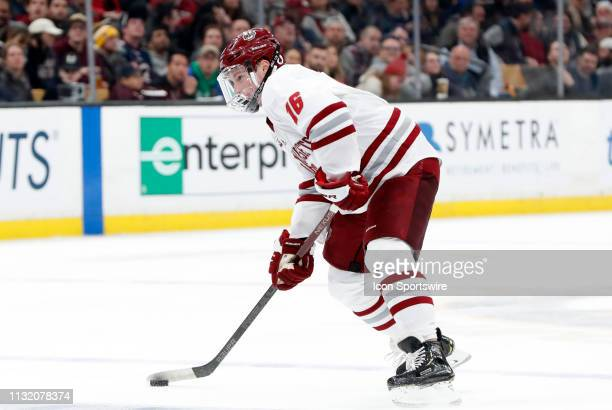 Minutemen defenseman Cale Makar sets up a shot during a Hockey East semifinal game between the Boston College Eagles and the UMASS Minutemen on March...