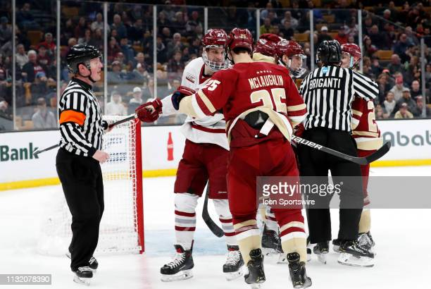 Minutemen defenseman Jake McLaughlin and Boston College Eagles forward Mark McLaughlin mix it up during a Hockey East semifinal game between the...