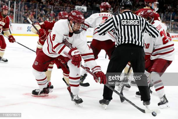 Minutemen forward Bobby Trivigno steals the face off during a Hockey East semifinal game between the Boston College Eagles and the UMASS Minutemen on...