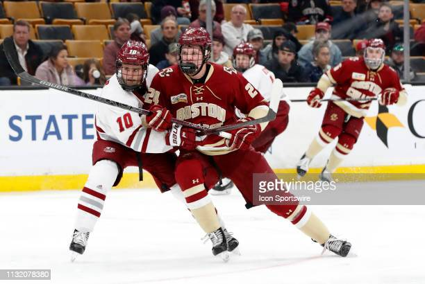 Minutemen forward Jack Suter holds back Boston College Eagles forward Patrick Giles during a Hockey East semifinal game between the Boston College...