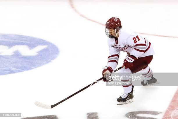 Minutemen forward Mitchell Chaffee controls the puck at center ice during the Northeast Regional final between the UMASS Minutemen and the Notre Dame...