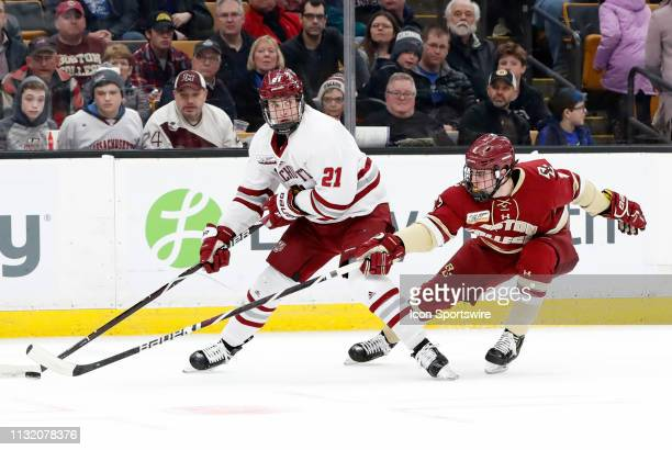 Minutemen forward Mitchell Chaffee looks for a trailer as Boston College Eagles defenseman Michael Karow defends during a Hockey East semifinal game...