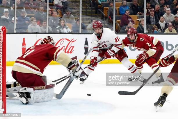 Minutemen forward Mitchell Chaffee puts a shot at Boston College Eagles goaltender Joseph Woll during a Hockey East semifinal game between the Boston...