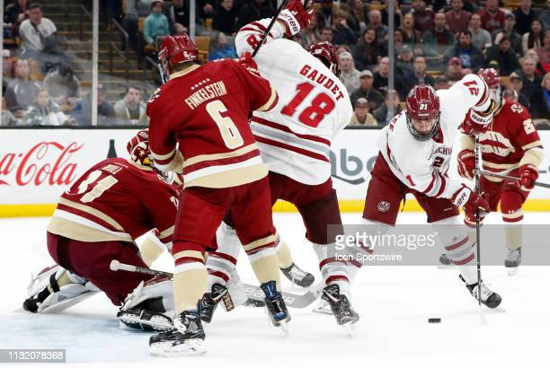 Minutemen forward Mitchell Chaffee sets up a backhander on Boston College Eagles goaltender Joseph Woll during a Hockey East semifinal game between...