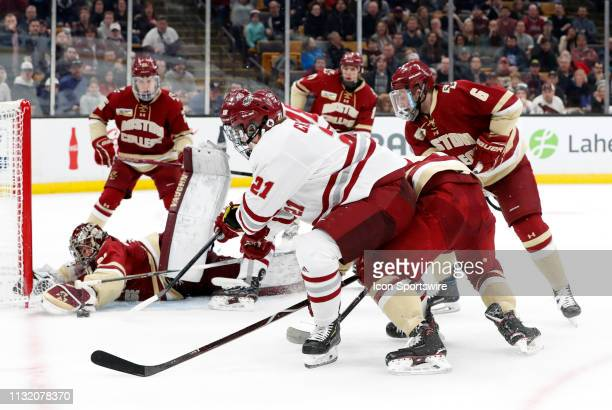 Minutemen forward Mitchell Chaffee tries to get at the puck as Boston College Eagles goaltender Joseph Woll moves in to cover during a Hockey East...