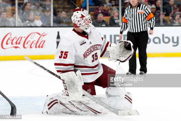 Minutemen goalie Filip Lindberg gloves a shot during a Hockey East semifinal game between the Boston College Eagles and the UMASS Minutemen on March...