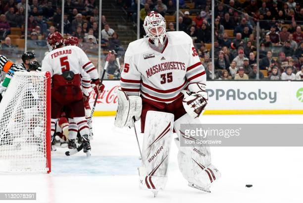 Minutemen goalie Filip Lindberg skates away from a scrum during a Hockey East semifinal game between the Boston College Eagles and the UMASS...