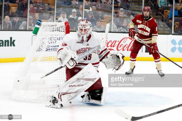 Minutemen goalie Filip Lindberg watches a rebound off the dasher during a Hockey East semifinal game between the Boston College Eagles and the UMASS...