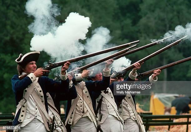 Minutemen Reenactors Shooting Rifles