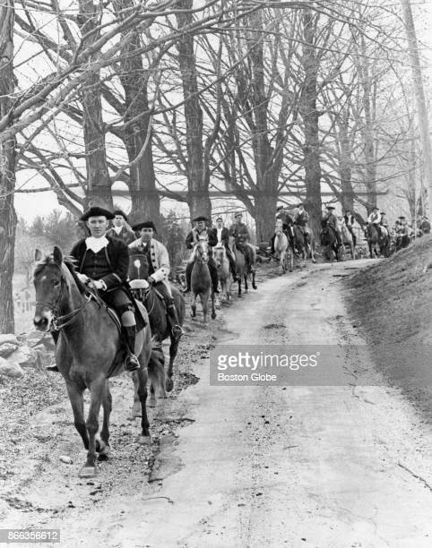 Minutemen ride horses through Sudbury Mass on April 20 on their way to Concord