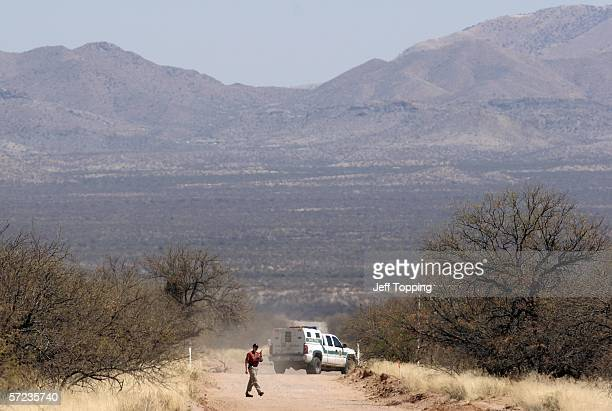 Minutemen volunteer walks back to his checkpoint after talking with a US Border Patrol agent on a ranch in the Sonoran Desert in Altar Valley April 2...