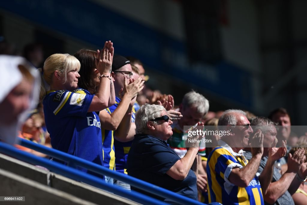 A minute's applause is held on 52 minutes in memory of Warrington Wolves fan Mike Naylor during the Ladbrokes Challenge Cup Quarter-Final match between Warrington Wolves and Wigan Warriors at Halliwell Jones Stadium on June 17, 2017 in Warrington, England.