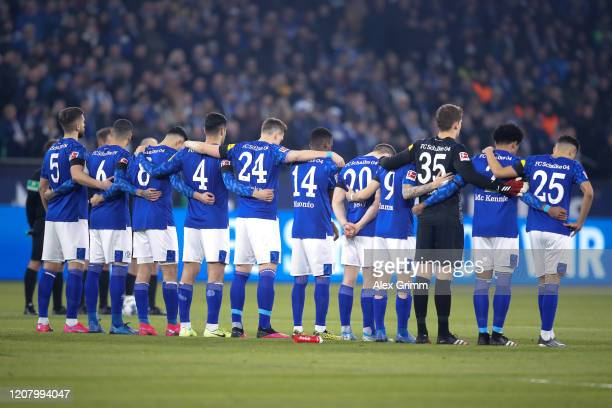 A minutes silence is observed by the players in remembrance of the victims of the Hanau prior to the Bundesliga match between FC Schalke 04 and RB...