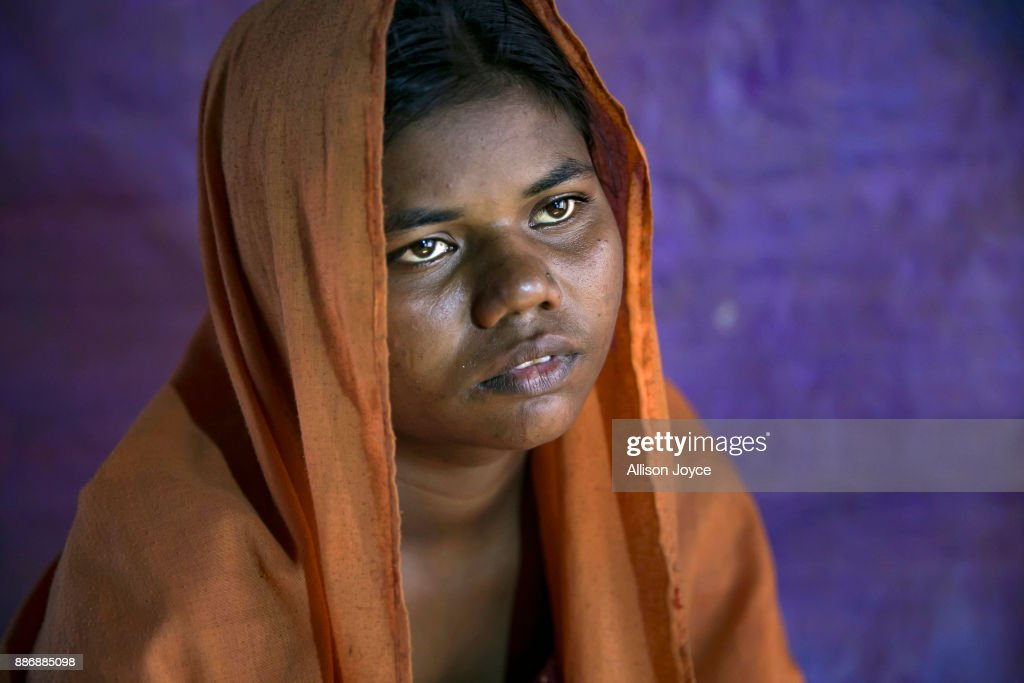 COX'S BAZAR, BANGLADESH - DECEMBER 01: Minwara Begum, 17, poses for a photo on December 1, 2017 in Cox's Bazar, Bangladesh. She fled to Bangladesh shortly after the August 25th attack from Tula Toli village in Myanmar. One morning she was cooking when she heard shooting. Her mom went out to see what was happening and saw the military throwing petrol bombs on all the houses. 'All of us started running and the military shot us in the back. They shot me, my mom, sister, sister in law, nephew, 2 of my brothers. I lost 6 members of my family. I just kept on running. The military found us where we were hiding and took me, my sister and cousin and other women to a house. They tied our eyes and legs and hands with a black cloth and started to rape me. I don't know how many men raped me. There were 6 of us in the room and they killed 3 of the women. When they were finished they left the house and threw a petrol bomb on it. The whole house caught fire and I used the fire to burn the cloth off that was keeping my legs and hands tied. I tried to help the other women in the house escape, I tried to carry them, but I was too weak. I crawled out through the small chicken door and hid in a paddy field. The other 5 women in the house all burned to death.Ó For days she hid in the paddy field and forest until a group of other people came through and helped her. She spent days walking with them to the Bangladesh border, where she took a boat across to Bangladesh. She spent a week in a hospital in Bangladesh until she recovered. 'Here in Bangladesh, I feel so restless and worried. People say they're going to send us back to Myanmar, and once again they'll shoot and beat us there. I'm so worried.' she says. 'They did these things to us, they raped us, I'm not afraid to talk about it. I don't feel ashamed to tell the world. I want justice, but I know the world cannot give me justice.