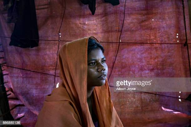 COX'S BAZAR BANGLADESH DECEMBER 01 Minwara Begum poses for a photo on December 1 2017 in Cox's Bazar Bangladesh She fled to Bangladesh shortly after...