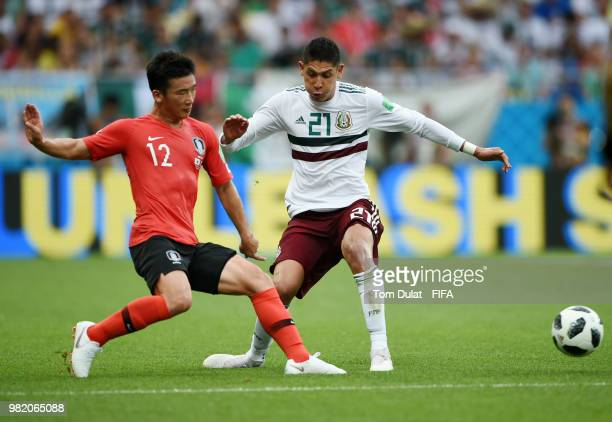 Minwoo Kim of Korea Republic tackles Edson Alvarez of Mexico during the 2018 FIFA World Cup Russia group F match between Korea Republic and Mexico at...