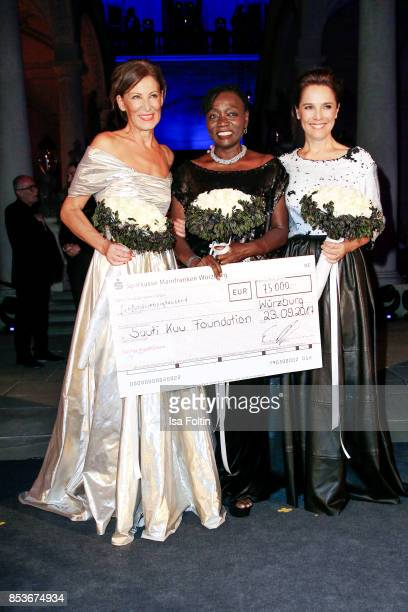 Minx Designer Eva Lutz Luxembourgian presenter Desiree Nosbusch and Auma Obama halfsister of former US president Barack Obama during the Minx Fashion...