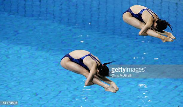 Minxia Wu and Jingjing Guo of China compete in the women's synchronised diving 3 metre springboard event on August 14 2004 during the Athens 2004...
