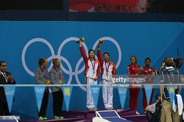 Minxia Wu and Zi He China winning the Gold Medal in the Women's Synchronised 3m springboard diving competition are watch by silver medal winner...
