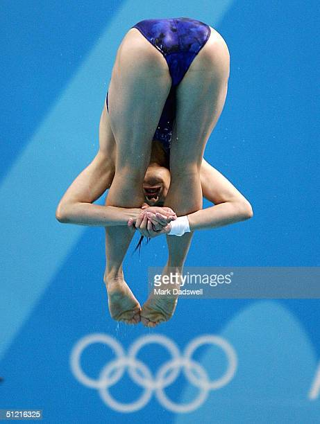Minxia Wu of China competes in the women's diving 3 metre springboard preliminary event on August 25 2004 during the Athens 2004 Summer Olympic Games...