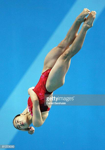 Minxia Wu of China performs a dive in the women's diving 3 metre springboard final event on August 26 2004 during the Athens 2004 Summer Olympic...
