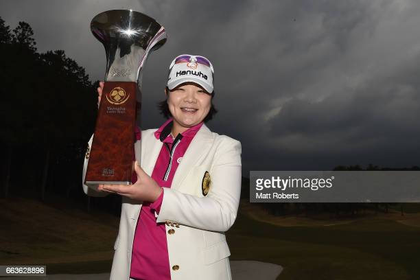 MinYoung Lee of Korea holds the winners trophy after the final round of the YAMAHA Ladies Open Katsuragi at the Katsuragi Golf Club Yamana Course on...