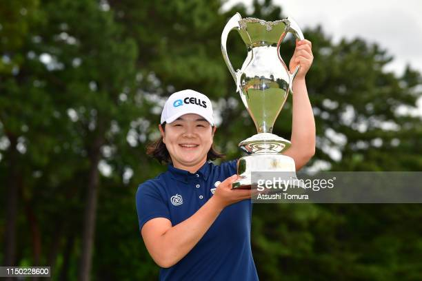 MinYoung Lee of South Korea poses for photographs with the trophy during the award ceremony following the HokennoMadoguchi Ladies at Fukuoka Country...