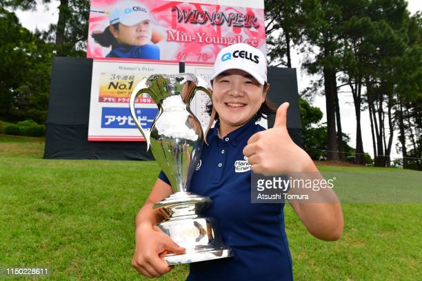 MinYoung Lee of South Korea poses for photographs with the trophy after the award ceremony following the HokennoMadoguchi Ladies at Fukuoka Country...