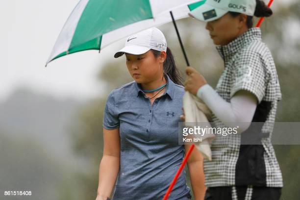 Mio Kotaki of Japan watches on the 17th hole during the final round of the Udonken Ladies at the Mannou Hills Country Club on October 15 2017 in...