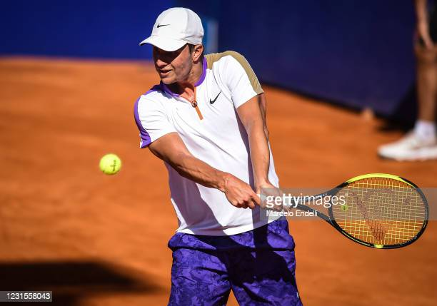 Miomir Kecmanovic of Serbia hits a backhand during a match against Diego Schwartzman of Argentina with a part of second semifinal during day 6 of ATP...