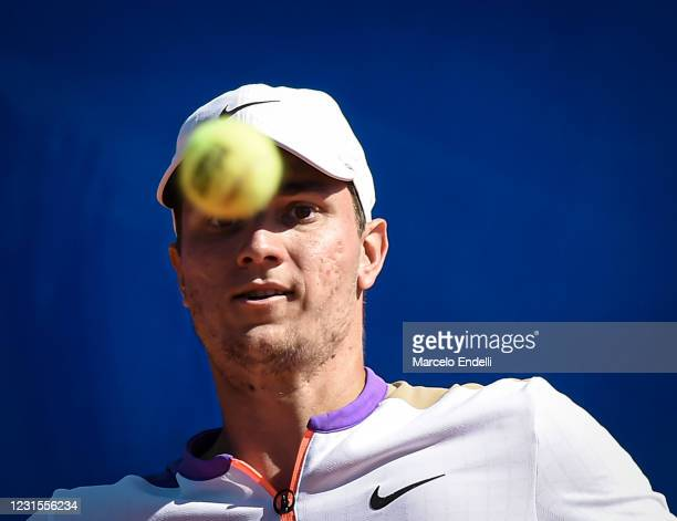 Miomir Kecmanovic of Serbia looks at the ball during a match against Diego Schwartzman of Argentina with a part of second semifinal during day 6 of...
