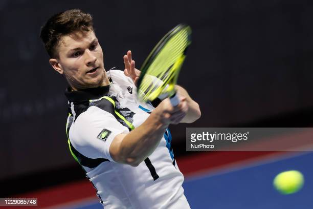 Miomir Kecmanovic of Serbia returns the ball to Cameron Norrie of Great Britain during their ATP St Petersburg Open 2020 international tennis...