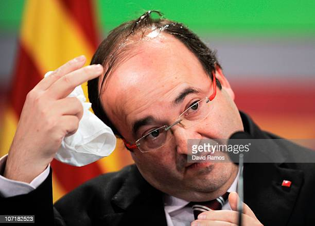 Miquel Iceta spokesman of the Catalan Socialist Party cleans his head after being hit by a egg thrown by a rightwing extemist as he was giving his...