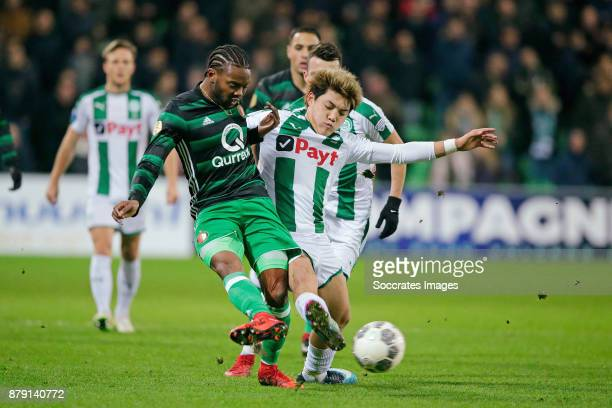 Miquel Nelom of Feyenoord Ritsu Doan of FC Groningen during the Dutch Eredivisie match between FC Groningen v Feyenoord at the NoordLease Stadium on...