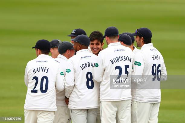 Mir Hamza of Sussex celebrates claiming the wicket of Ateeq Javid of Leicestershire during the Specsavers County Championship Division Two between...