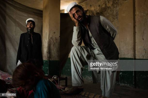 Mir Jamar a father of 9 watches his family inside the remains of an old Soviet hotel where they have been living for the past two years on July 15...
