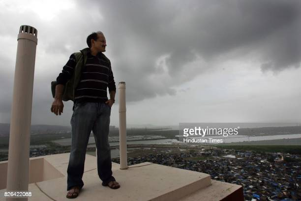 SRK Mir Ranjan Negi Hockey player Niranjan Negi takes in a bird's eye view of the city from his terrace in the early morning on the eve of the launch...