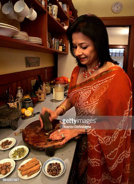 Mira Adveni in her kitchen crushing spices in preparation to cook Garam masala game hens with rice pilaf and sweet and spicy butternut squash in...