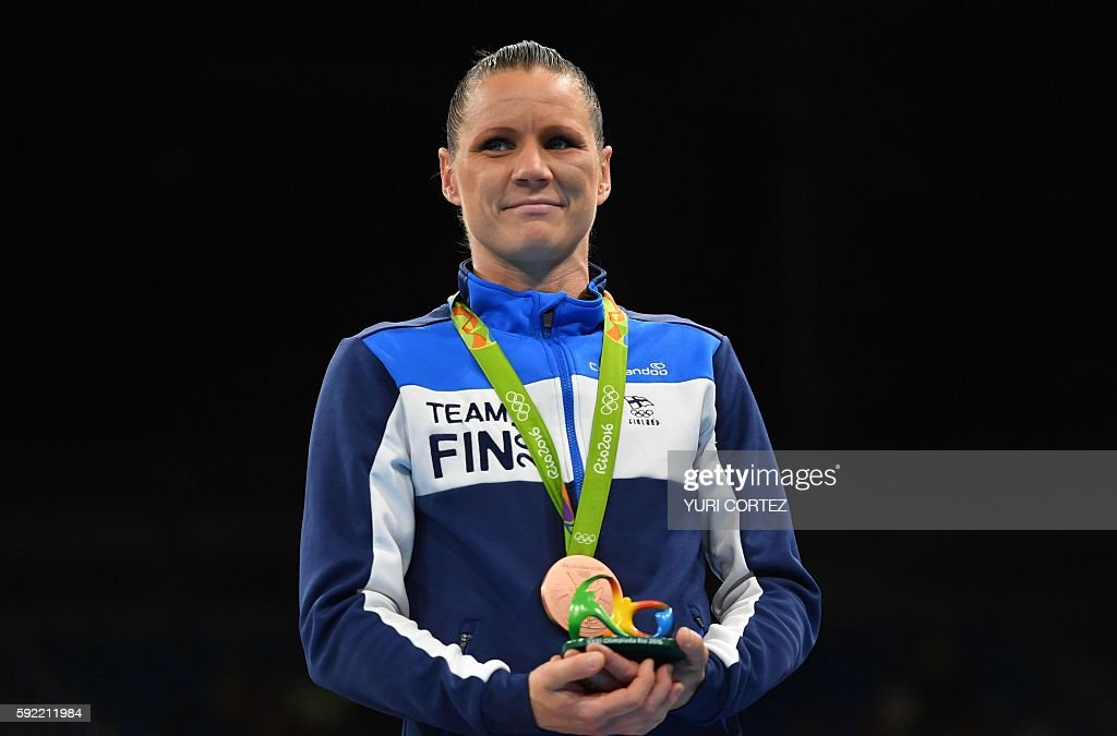 Mira Potkonen of Finland poses with a bronze medal following a boxing match at the Rio 2016 Olympic Games at the Riocentro - Pavilion 6 in Rio de Janeiro on August 19, 2016. Estelle Mossely celebrated her birthday in style by punching her way into the history books as she became the first Frenchwoman to win Olympic boxing gold on August 19, 2016. / AFP / Yuri CORTEZ