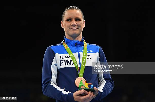 Mira Potkonen of Finland poses with a bronze medal following a boxing match at the Rio 2016 Olympic Games at the Riocentro Pavilion 6 in Rio de...